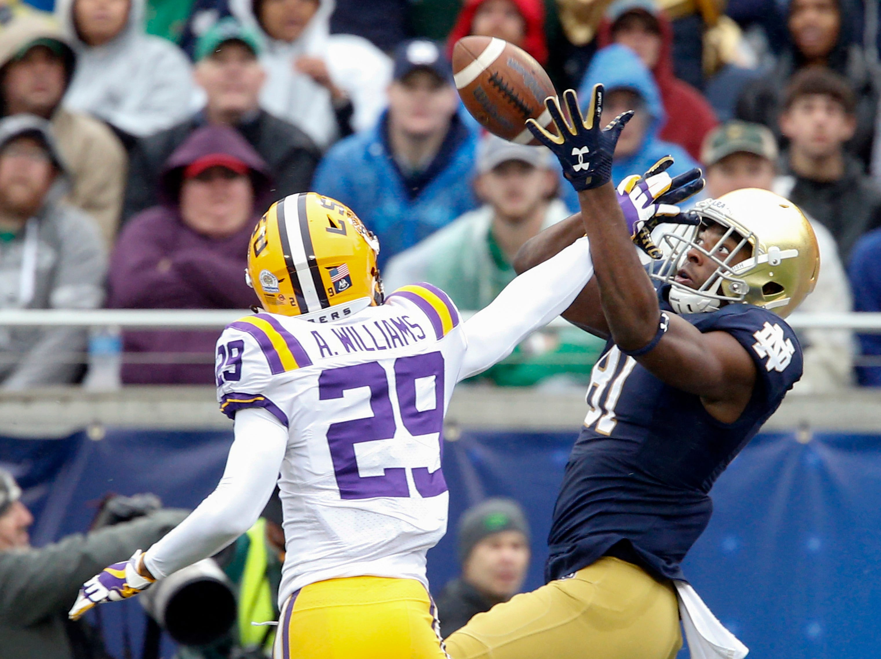 Jan 1, 2018; Orlando, FL, USA; LSU Tigers cornerback Andraez Williams (29) breaks up a pass to Notre Dame Fighting Irish wide receiver Miles Boykin (81) during the first quarter in the 2018 Citrus Bowl at Camping World Stadium. Mandatory Credit: Reinhold Matay-USA TODAY Sports