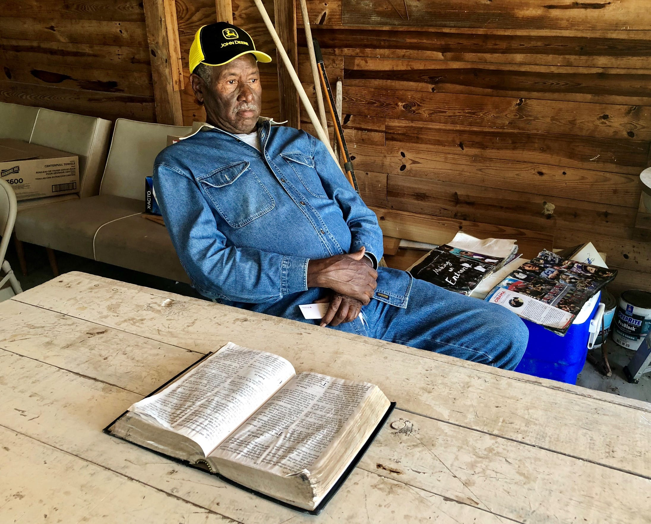 James Espree, a 40-year member of Mt. Pleasant Baptist Church in Opelousas, reads Psalm 23 in his Bible in a shop located next to the burned church building April 15, 2019. It is one of three predominately black Baptist churches in St. Landry Parish to have been burned in a span of 10 days.