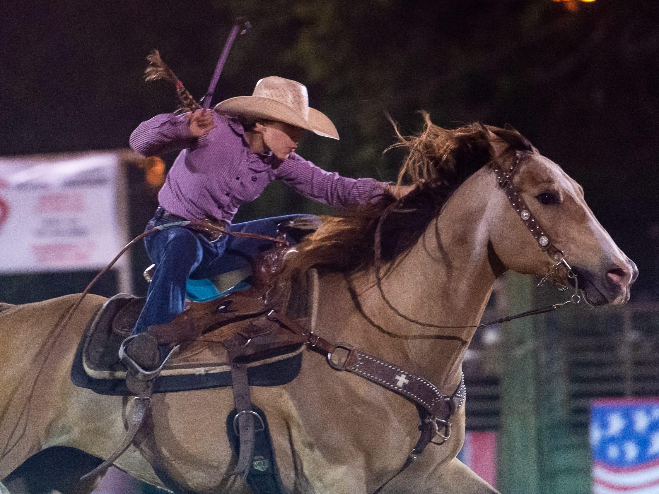 Barrel Racer Libbi Boudreaux as the Cajun Rodeo Association host the Cowboys Spring Stampede 19 Rodeo at Cowboys Arena in Scott, LA. Saturday, April 13, 2019.