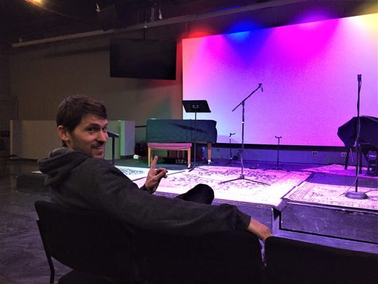 Good Sense Coffee owner Ian Boyle sits in The Well Church's worship auditorium Monday, April 15, 2019 where he plans to host concerts and other performing arts events.