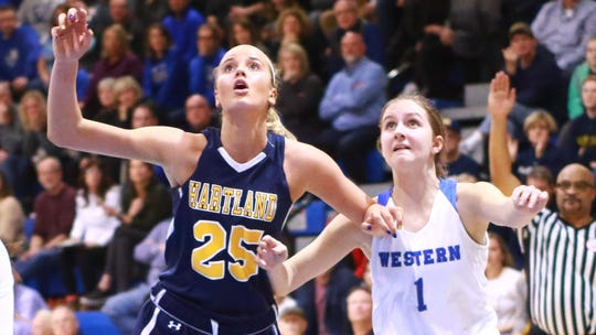 Whitney Sollom boxes out Walled Lake Western's Zoe DeRoche in Hartland's 50-46 Regional Final victory over the Warriors Wednesday March 13, 2019 at Lakeland High School.