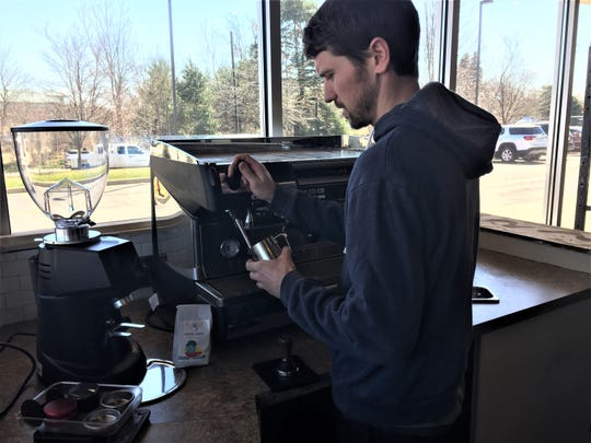 Good Sense Coffee owner Ian Boyle talks about coffee roasting Monday, April 15, 2019 at the store he will open soon in Genoa Township.