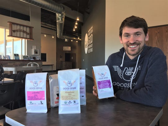 Good Sense Coffee owner Ian Boyle shows some of the coffees he roasts Monday, April 15, 2019 in his first brick-and-mortar shop, which he will open soon in Genoa Township.