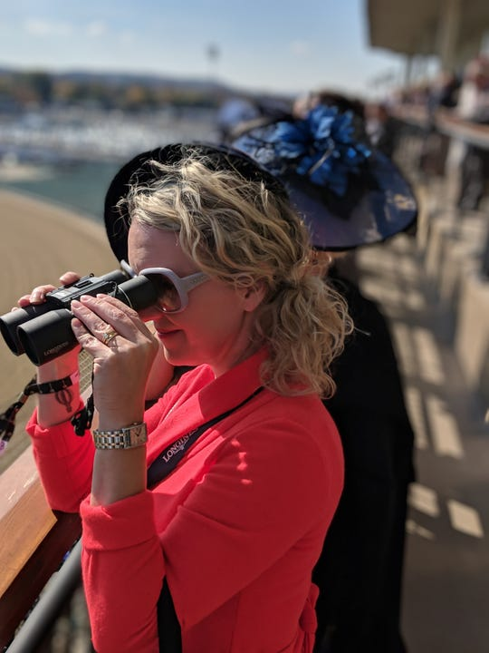 Courier Journal freelancer writer Dana McMahan takes a look at the Churchill Downs racetrack from The Mansion during the 2018 Breeders' Cup.