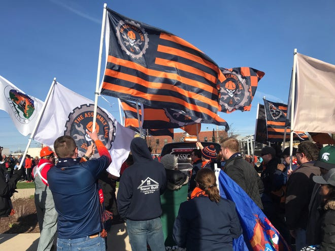 Members of The Assembly Line, the Lansing Ignite's supporters' group, rally in front of Cooley Law School Stadium before the team's match on Saturday, April 13, 2019.