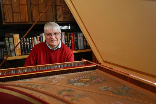 Wayne Wildman sits with one of his harpsichords at his home Tuesday, April 9, 2019, in Sheboygan, Wis. Joshua Clark/USA TODAY NETWORK-Wisconsin