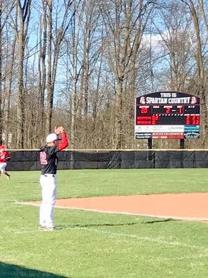Pleasant head baseball coach Brad Potts signals to a base runner during a game last season at Pleasant. The Spartans were going to be a young squad in 2020, especially on the pitching mound.