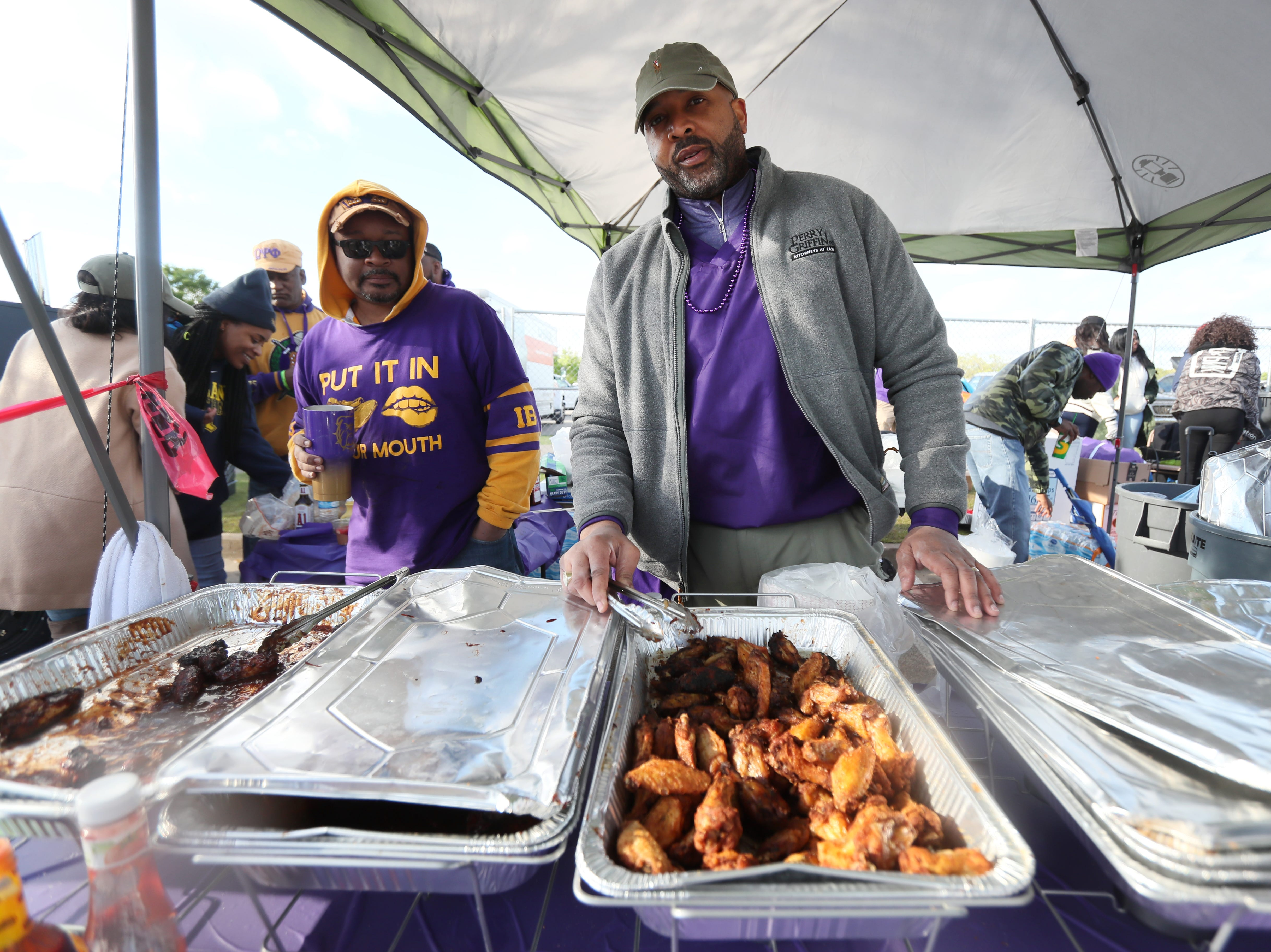 John Keith Perry serves up some food during the 17th Annual Southern Hot Wing Festival on Tiger Lane at Liberty Bowl Memorial Stadium on Sunday, April 14, 2019.