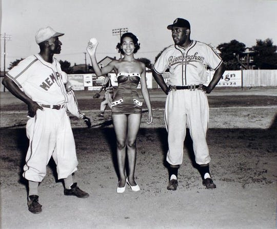 "Miss Memphis Red Sox 1954 is flanked by manager Homer ""Goose"" Curry and Lyman Bostock Sr. of the Birmingham Black Barons in Memphis' Martin Stadium."