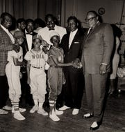 WDIA-sponsored Little League players meet legends of rhythm and blues, including, from right, Big Joe Turner, Muddy Waters, Howlin' Wolf and B.B. King.