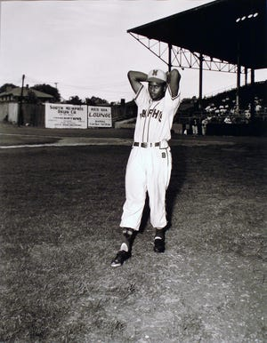 Before he was a country music legend, Charley Pride was a pitcher with the Memphis Red Sox, as seen in this 1952 photo.