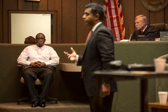 In this August 25, 2016 file photo, Criminal Court Judge Jim Lammey presides over the trial of Roger Reed (at left) who was charged in the killing of pastor Don Smith. Here, Reed answers questions from his attorney Juni Ganguli (center). A jury later convicted Reed of first-degree murder. Lammey sentenced him to life in prison.