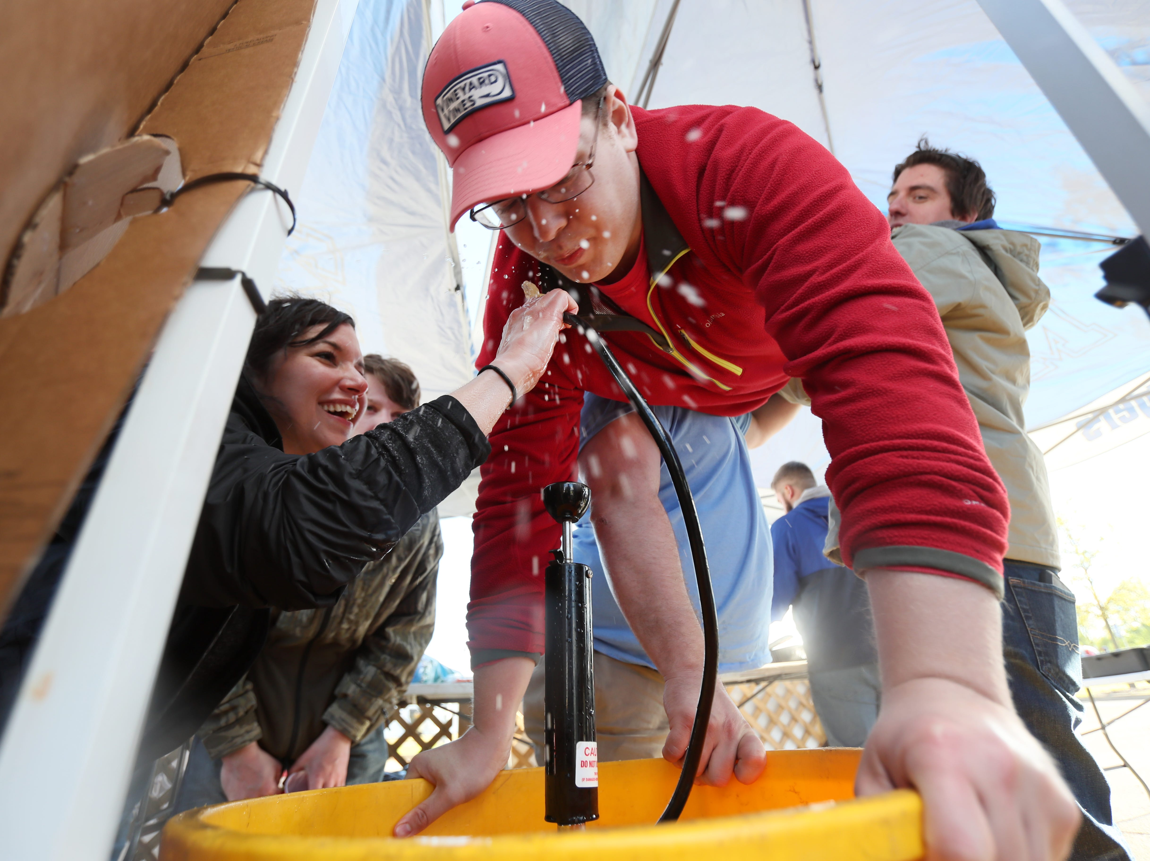 Adam, last name withheld, takes a keg stand during the 17th Annual Southern Hot Wing Festival on Tiger Lane at Liberty Bowl Memorial Stadium on Sunday, April 14, 2019.