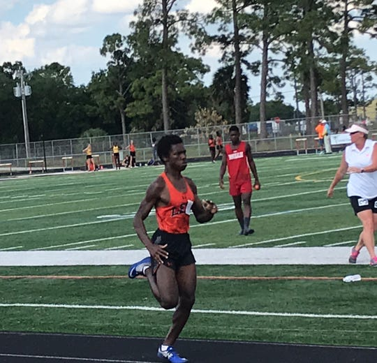 Lely's Quentin Warren sprints toward the finish line during the 800-meter race at Friday's district track meet at Immokalee. Warren won the event.