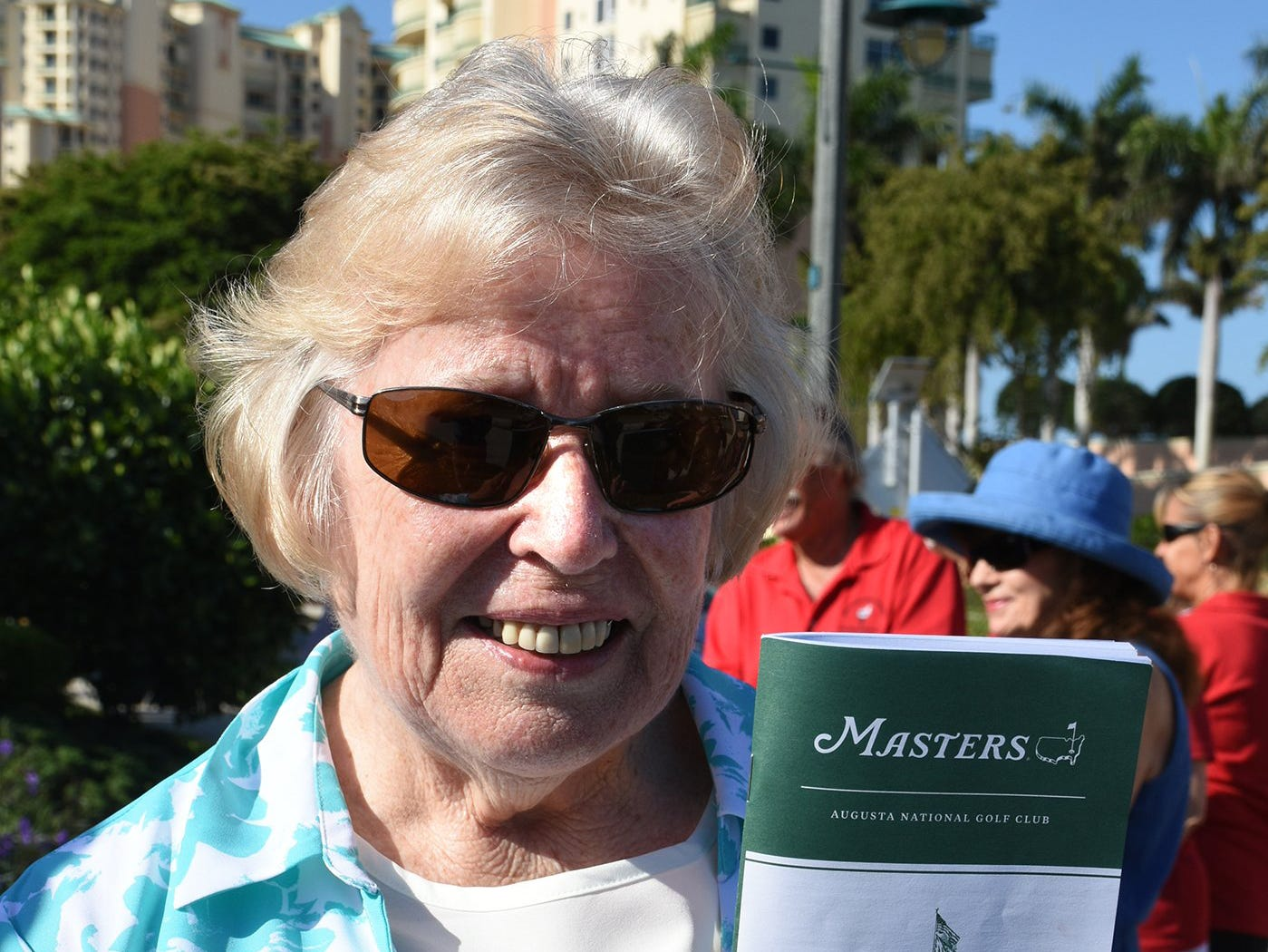 Mary Ann Sarazen, golf legend Gene Sarazewn's daughter, with a booklet from the Masters golf tournament. Friday morning, the Marco Island Foundation for the Arts unveiled a plaque with the names of donors who have contributed to the purchase of the Double Eagle sculpture at Sarazen Park on Marco.