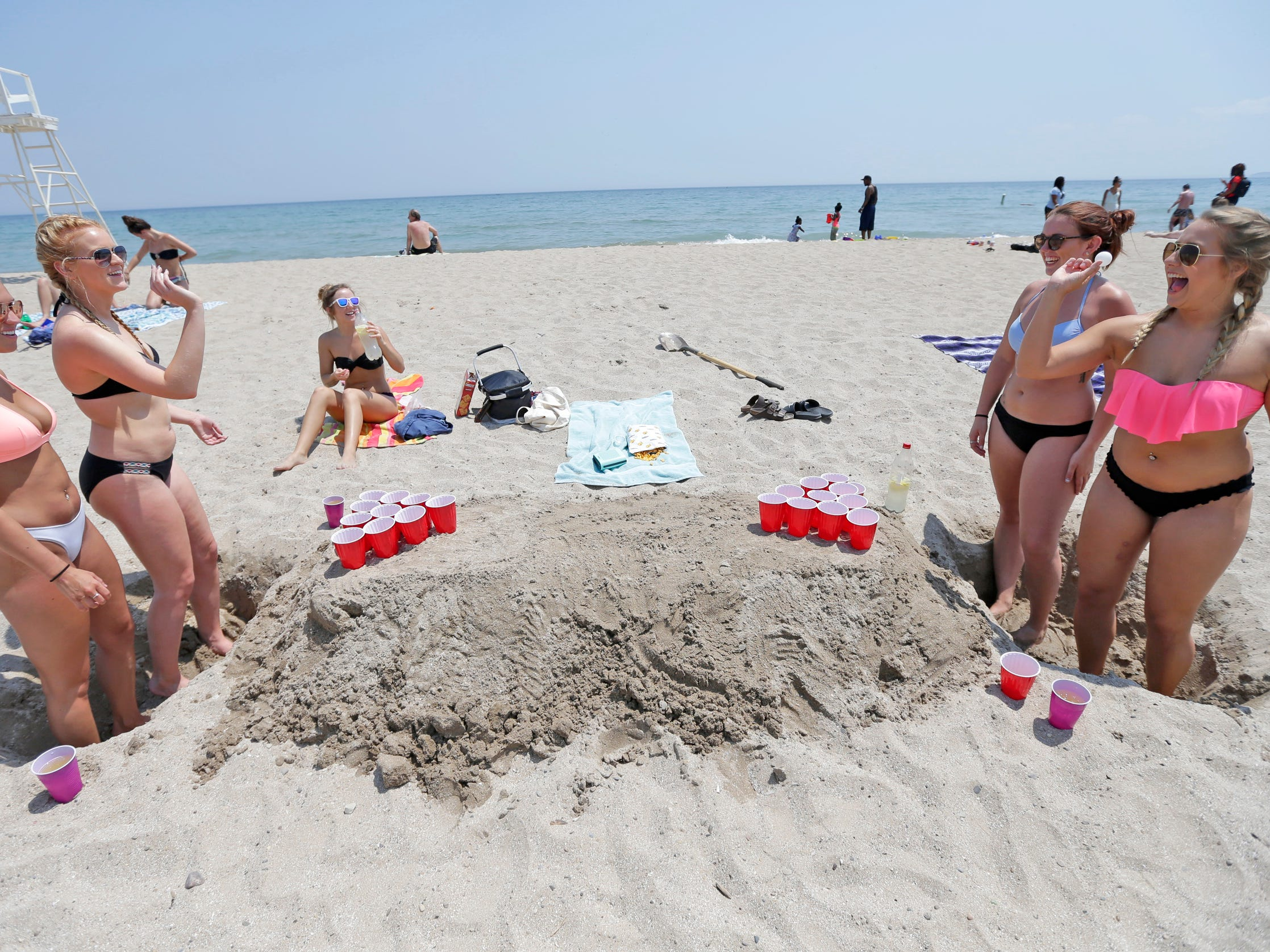 Kayla Swanson (from left), 19, of Kenosha, Kayla Hinze, 19, of Racine, Naomi Campbell, 20, of Cedarburg, and Caitlyn Slaasted, 20, of Union Grove play a game on Bradford Beach.