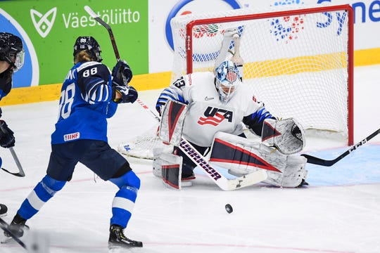 Ronja Savolainen (left) of Finland in action against US goalie Alex Rigsby during the 2019 IIHF Ice Hockey Women's World Championship match between Finland and the USA in Espoo, Finland.