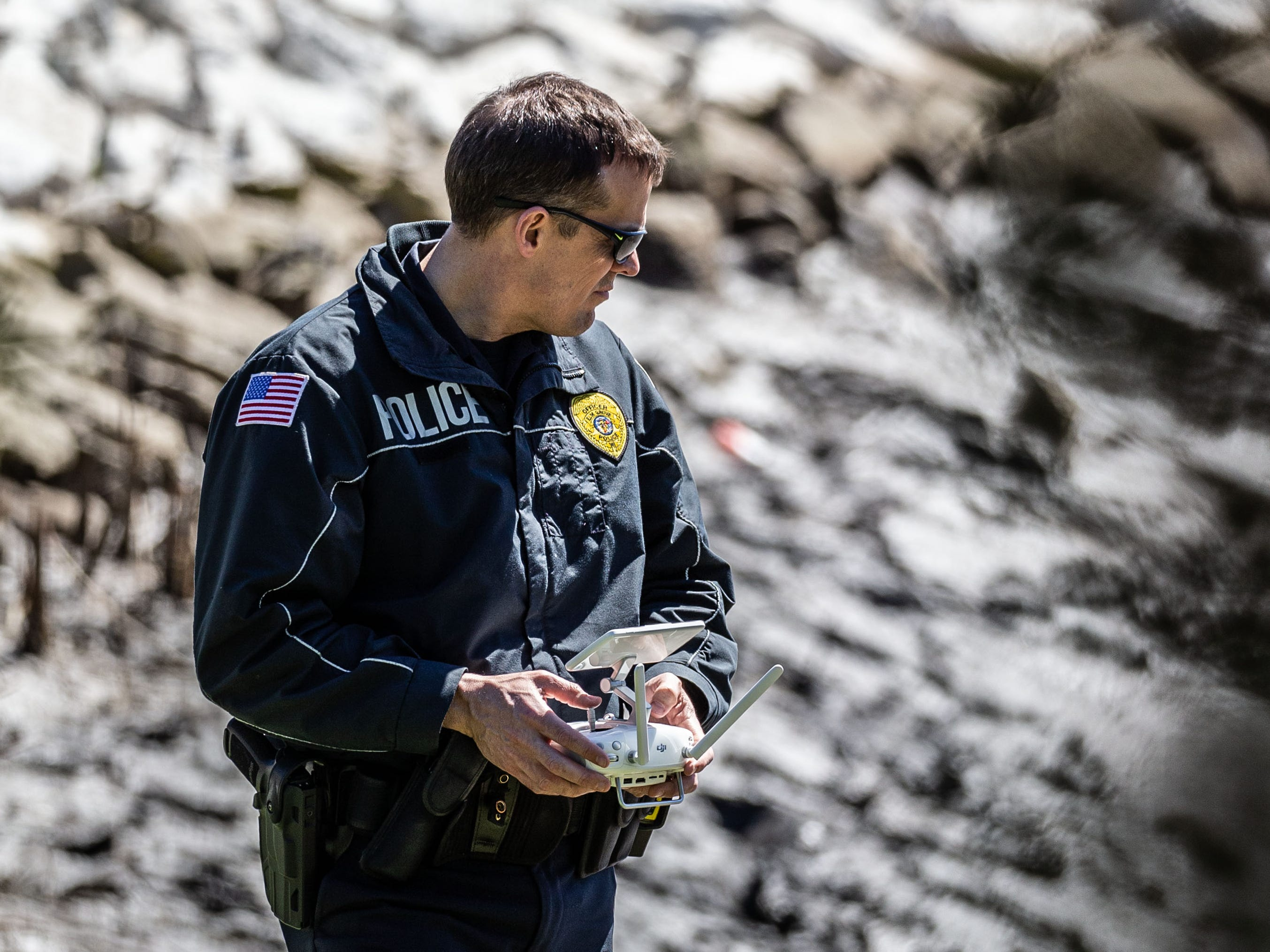 An Elm Grove police officer uses a drone to assist the Town of Brookfield police as they search for evidence in a drained pond at the Brookfield Lake Condominiums on Monday, April 15, 2019. The search is related to a November homicide.