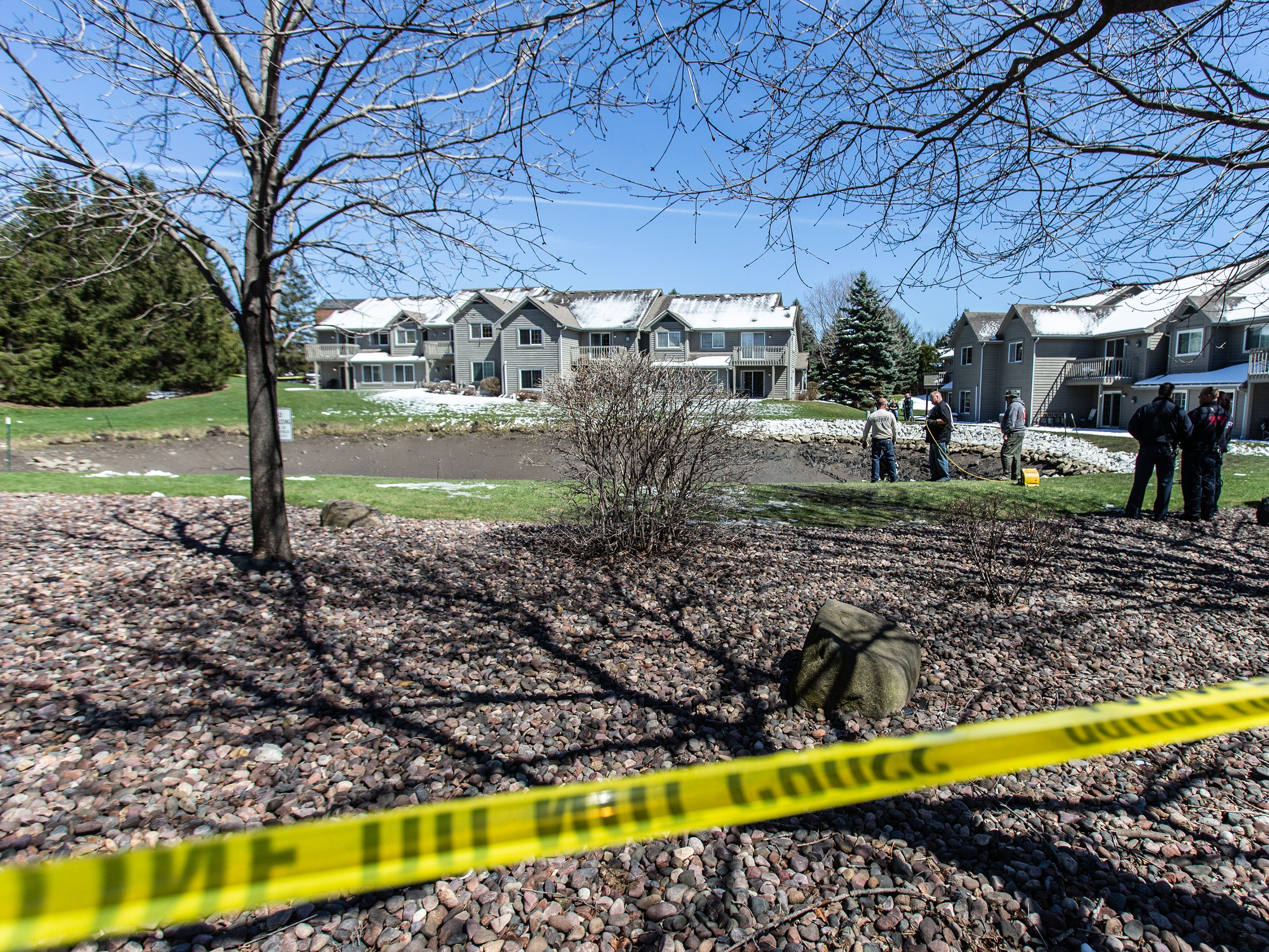 The Town of Brookfield Police search for evidence in a drained pond at the Brookfield Lake Condominiums on Monday, April 15, 2019 with assistance from the Waukesha County Sheriff's Dive Team and the Elm Grove Police Department's drone. The search is related to a November homicide.