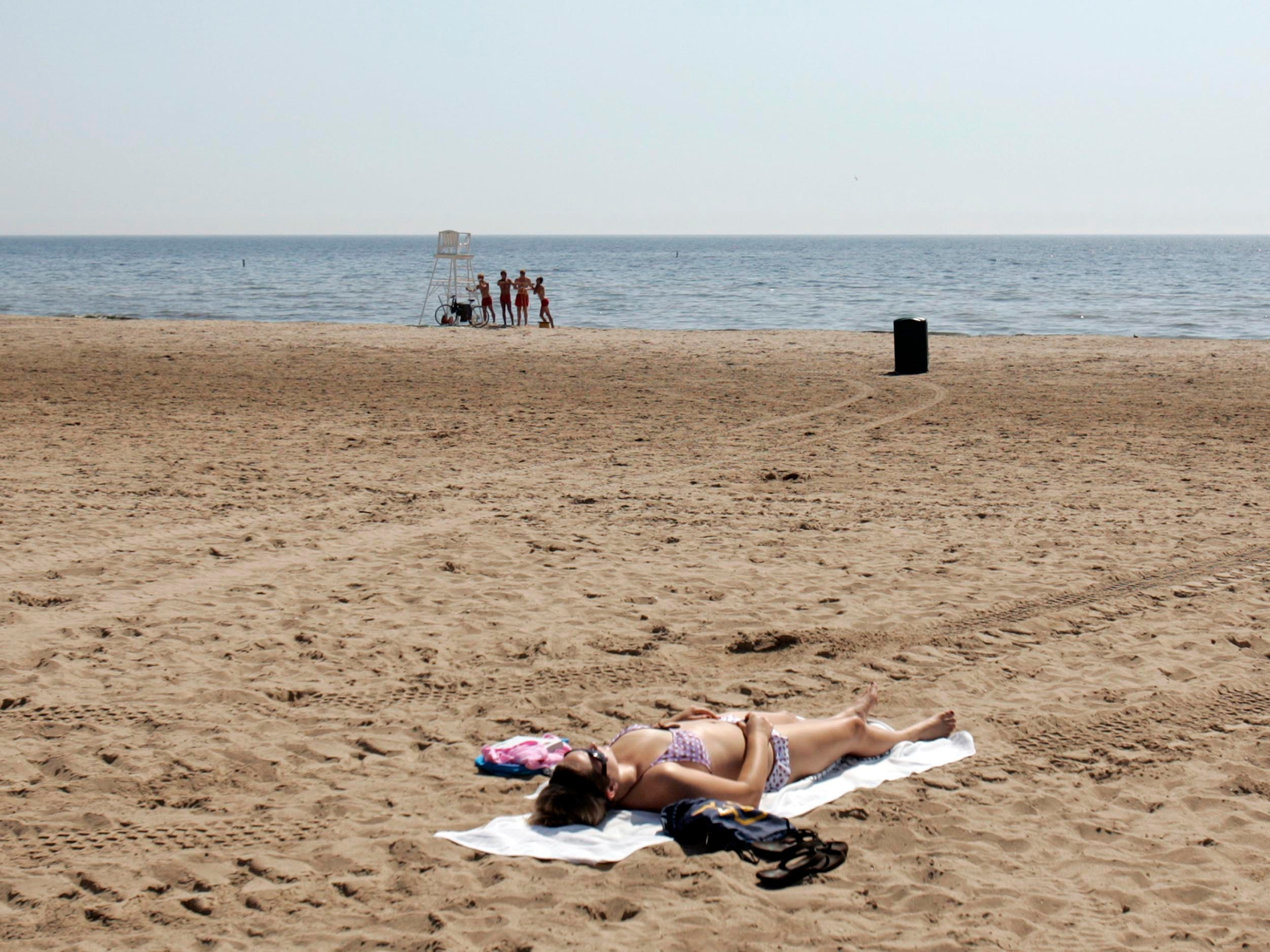 Chelsey Foscato, 21, a senior at Marquette University, has Bradford Beach all to herself.