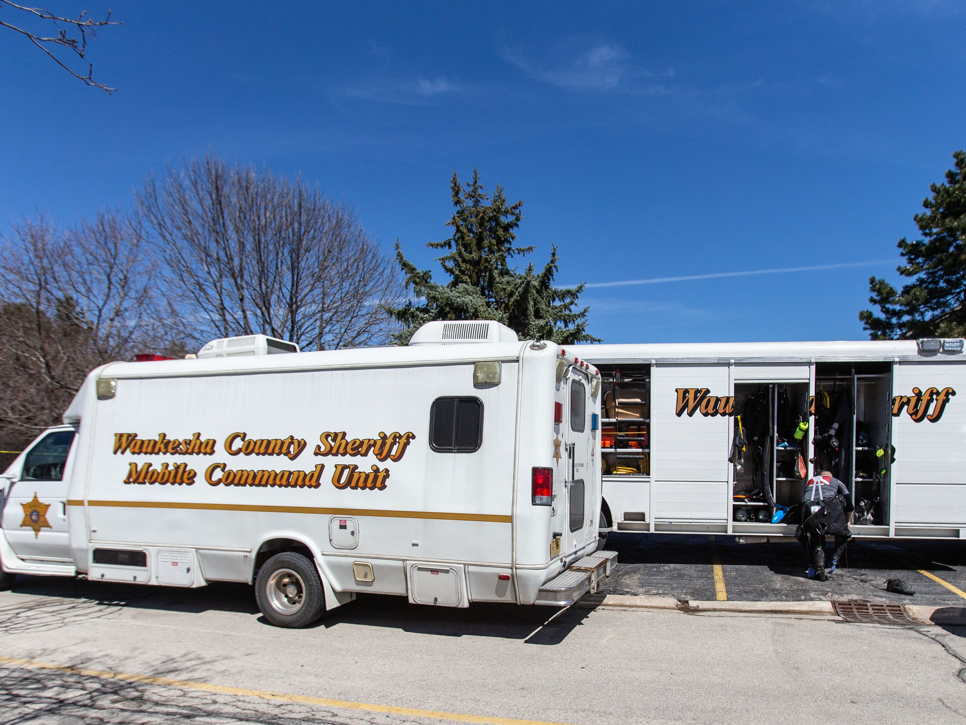 The Waukesha County Sheriff's Mobile Command Unit and Dive Team assist the Town of Brookfield Police as they search a drained pond at the Brookfield Lake Condominiums on Monday, April 15, 2019. The search is related to a November homicide.