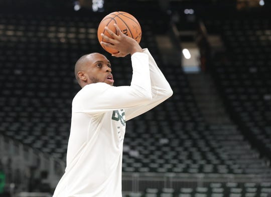 Khris Middleton warms up prior to the game.