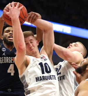 Former Marquette forwards Sam and Joey Hauser announced transfer plans Tuesday,