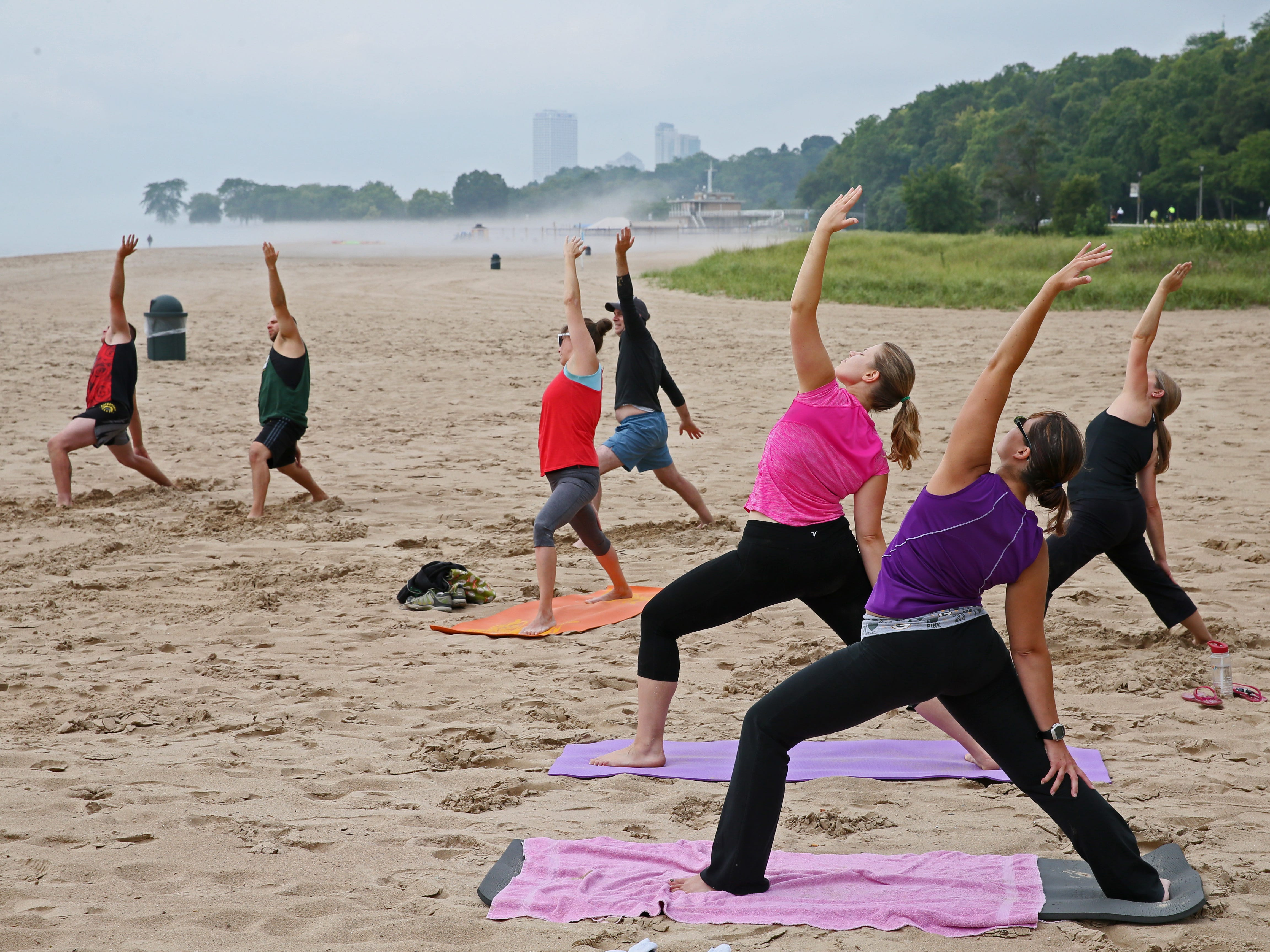 Students take part in a yoga class on Bradford Beach.