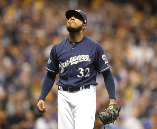 Milwaukee Brewers relief pitcher Jeremy Jeffress (32) finishes retiring the side in the 8th inning during game two of the Milwaukee Brewers vs. Colorado Rockies National league Division Series.
