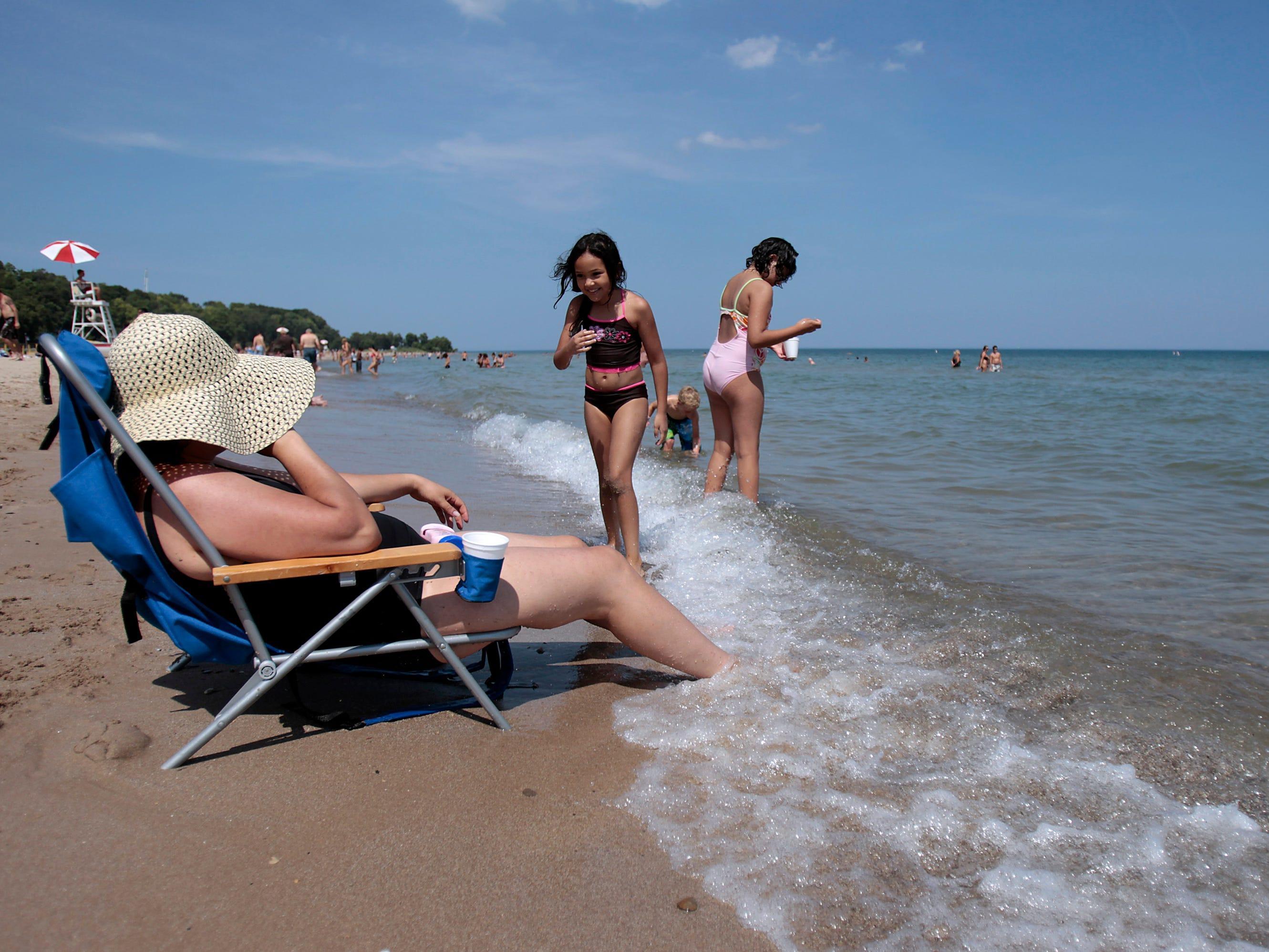 Nadia Elouaski keeps her feet cool at Bradford Beach during a heat wave.