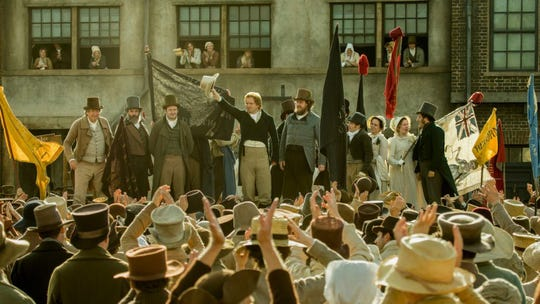 """Reformers rally the crowd, before the government strikes back, in """"Peterloo."""""""