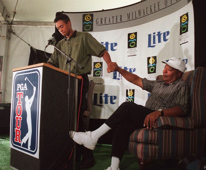Tiger Woods thanks his father, Earl, after announcing he was turning pro at the Greater Milwaukee Open in August 1996.