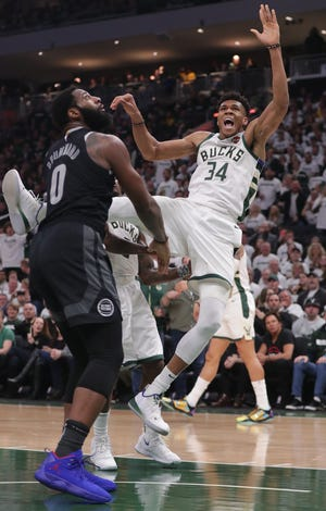 Bucks forward Giannis Antetokounmpo is fouled by Detroit Pistons center Andre Drummond in Game 1. Drummond was ejected for a flagrant foul.
