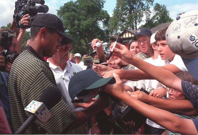Tiger Woods signs autographs in Milwaukee on Aug. 28, 1996, during his first weekend as a professional golfer.