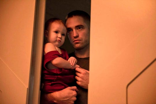 "Robert Pattinson is fighting for his life, and for his young daughter's, in the interstellar drama ""High Life."""