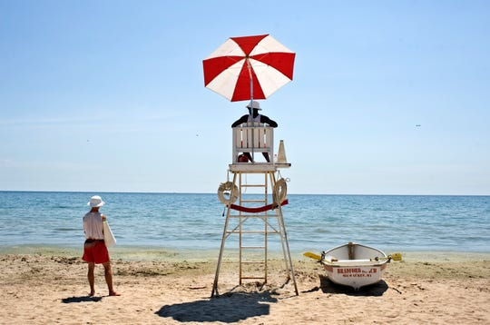 Lifeguards Nathaniel Scharping (left) and Lance Dorsey watch over Lake Michigan at Bradford Beach.