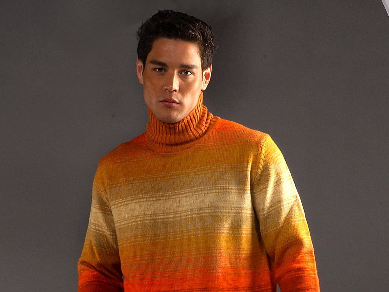 Striped turtleneck sweater and cotton pants.