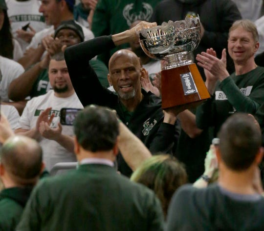 Kareem Abdul-Jabbar holds the 1971 NBA championship trophy at Fiserv Forum on April 14, 2019.