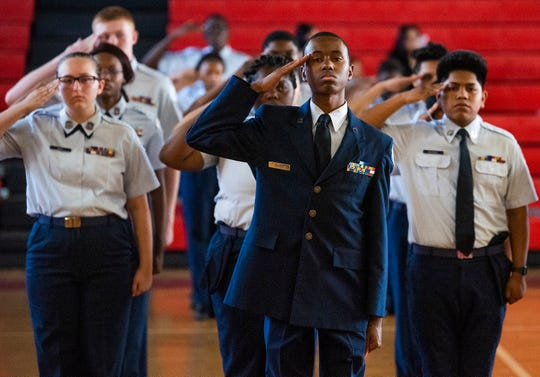 Air Force JROTC at Lee High School hold a ceremony as Lee student Ty'Asia Brown is presented a $10,000 Red Tail Scholarship for flight training at the Lee campus in Montgomery, Ala., on Monday April 15, 2019.