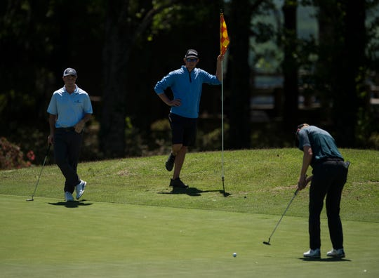 Hunter Hamrick of Montgomery, left, wait to putt on the 18th hole during Web.com Tour's Robert Trent Jones Golf Trail Championship qualifier at Capitol Hill golf course in Prattville, Ala., on Monday, April 15, 2019.