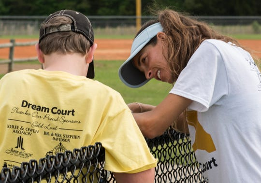 Jessica Weyreuter, founder of Dream Court, greets an athlete at Thompson Park in Montgomery, Ala., on Saturday, April 13, 2019. Dream Court is a non-profit tennis program for special needs athletes.