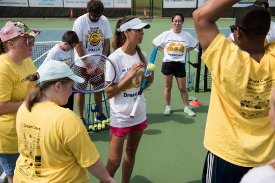 Jessica Weyreuter, founder of Dream Court, huddles with her athletes and volunteers at Thompson Park in Montgomery, Ala., on Saturday, April 13, 2019. Dream Court is a non-profit tennis program for special needs athletes.