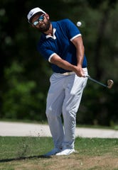 Robbie Blackwell of Prattville chips onto the green at the 17th hole during Web.com Tour's Robert Trent Jones Golf Trail Championship qualifier at Capitol Hill golf course in Prattville, Ala., on Monday, April 15, 2019.