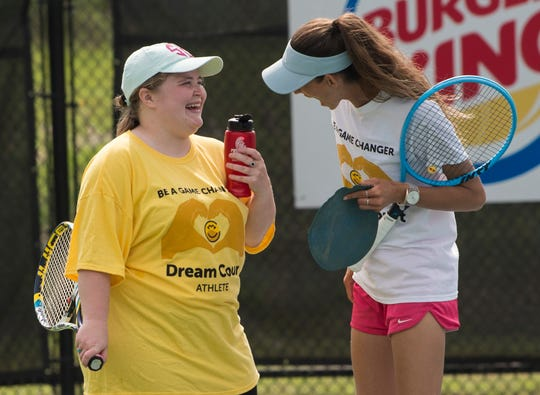 Shelby Bullen, left, jokes with Jessica Weyreuter, founder of Dream Court, during practice at Thompson Park in Montgomery, Ala., on Saturday, April 13, 2019. Dream Court is a non-profit tennis program for special needs athletes.