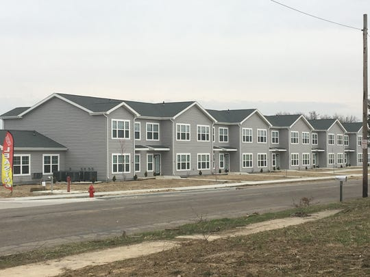 Affordable housing units have been built along West Eighth Street at the site of the former Chevrolet plant and are accepting applications for tenants.
