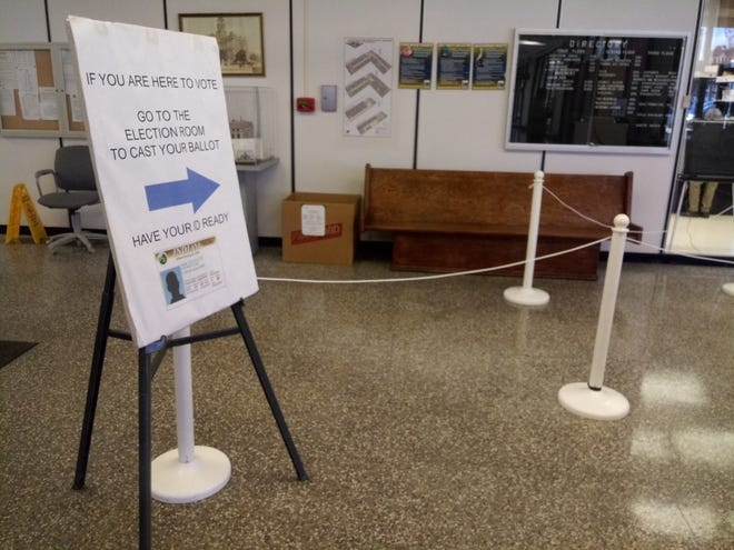 A sign for early voting brings voters through a currently empty line to the elections office on April 15 at the Delaware County Government Complex.