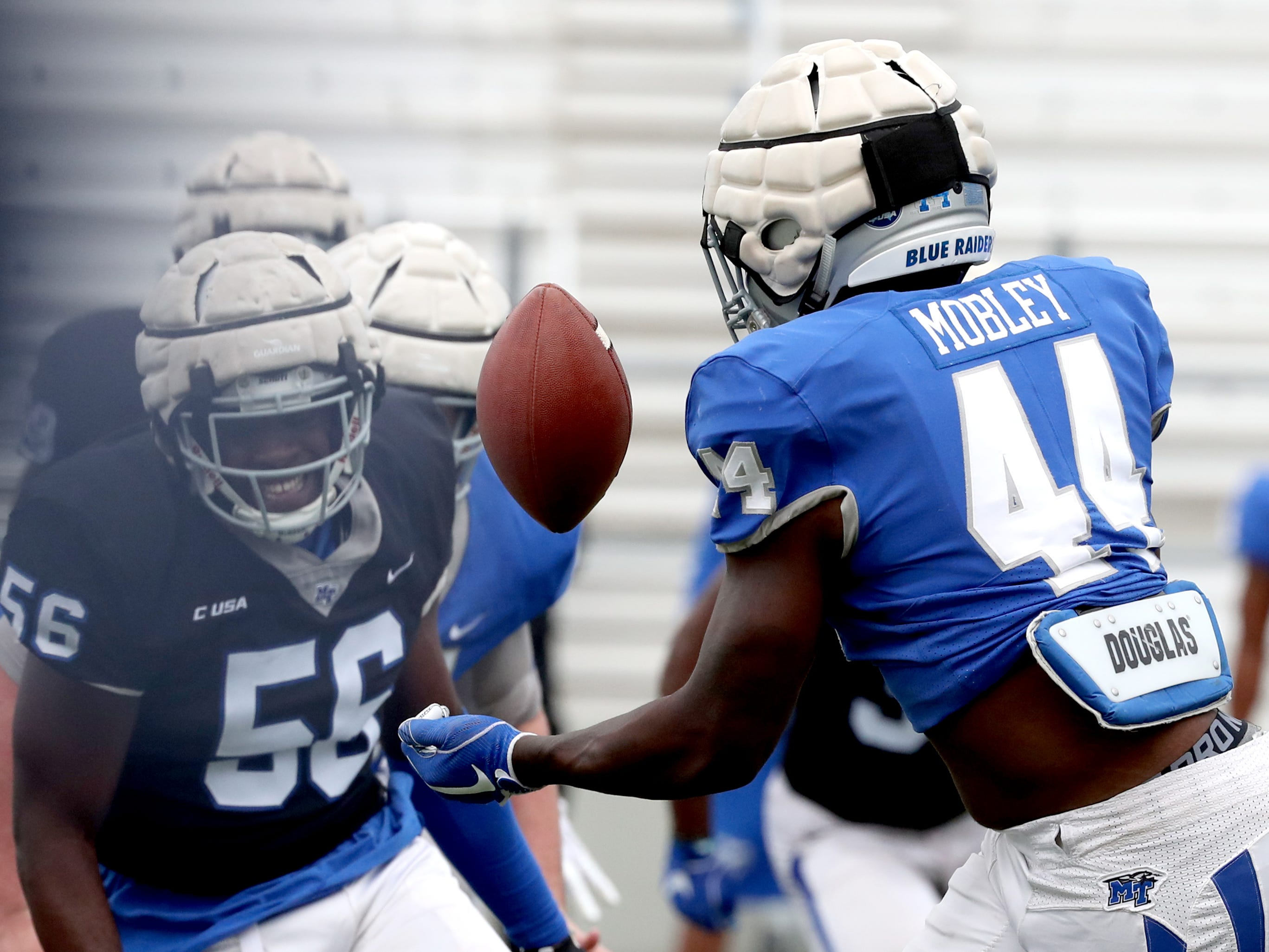 "MTSU's running back Chaton Mobley (44) catches the ball and runs during MTSU's Blue-White Spring Finale was held on Saturday April 13, 2019, at MTSU's Johnny ""Red"" Floyd Stadium."