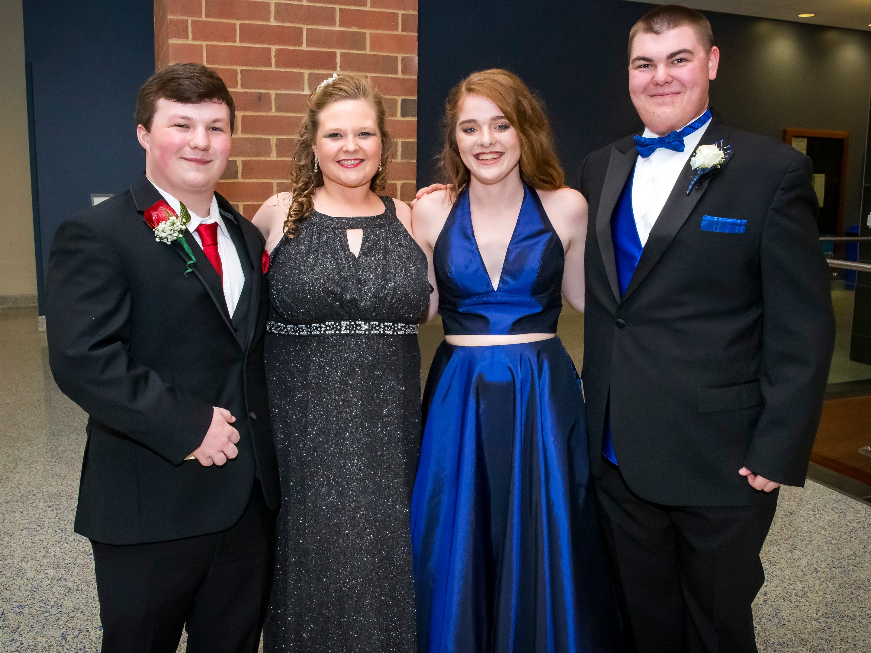 James Marshall, Brittany Milligen, Bethiany Freer and Claeb Smith arrive at Siegel High School prom at MTSU, Saturday, April 13, 2019.