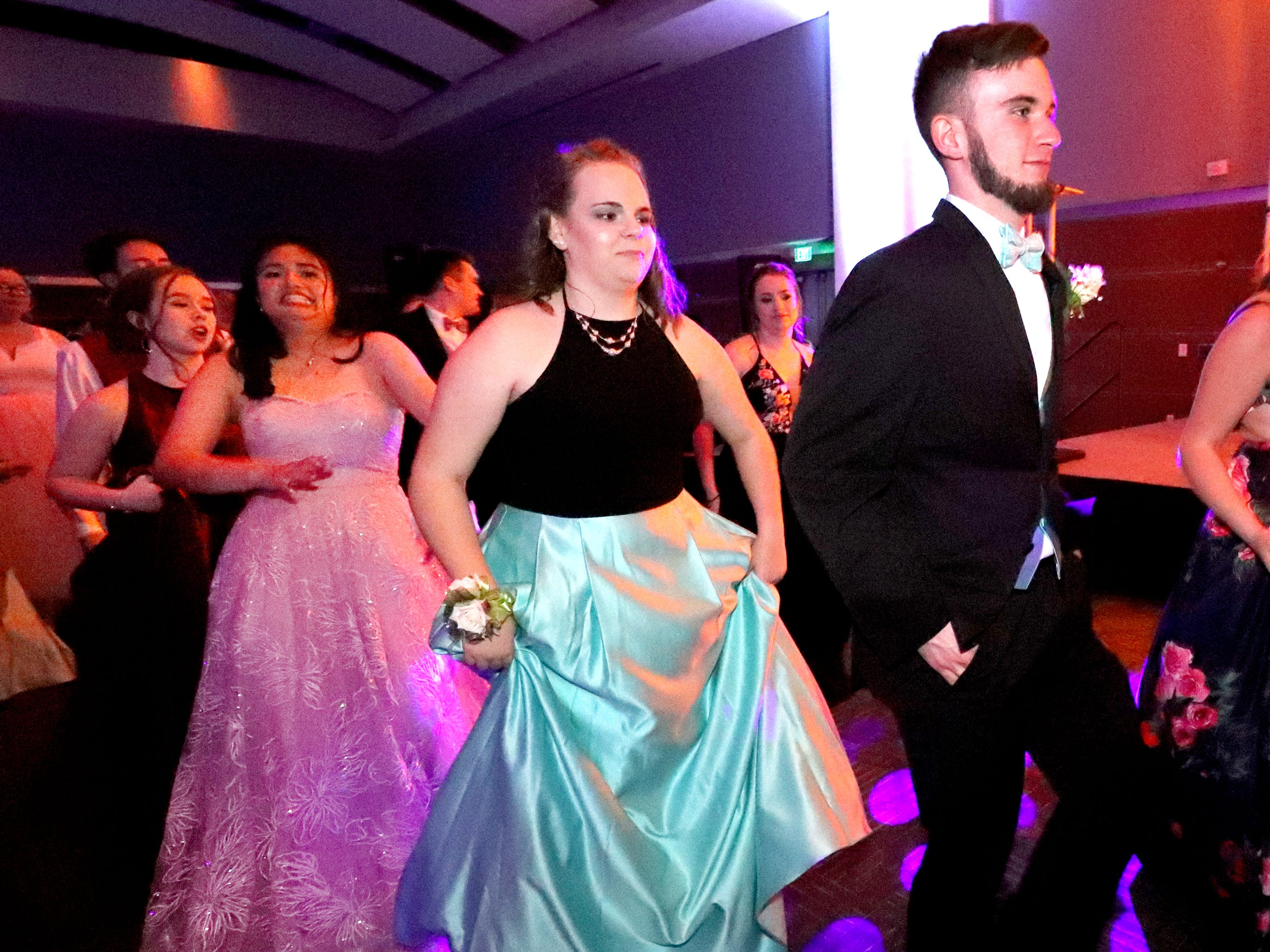 Justin Lane, right and Brianna Kane, left dance together at Blackman's prom on Friday April 12, 2019, at MTSU.