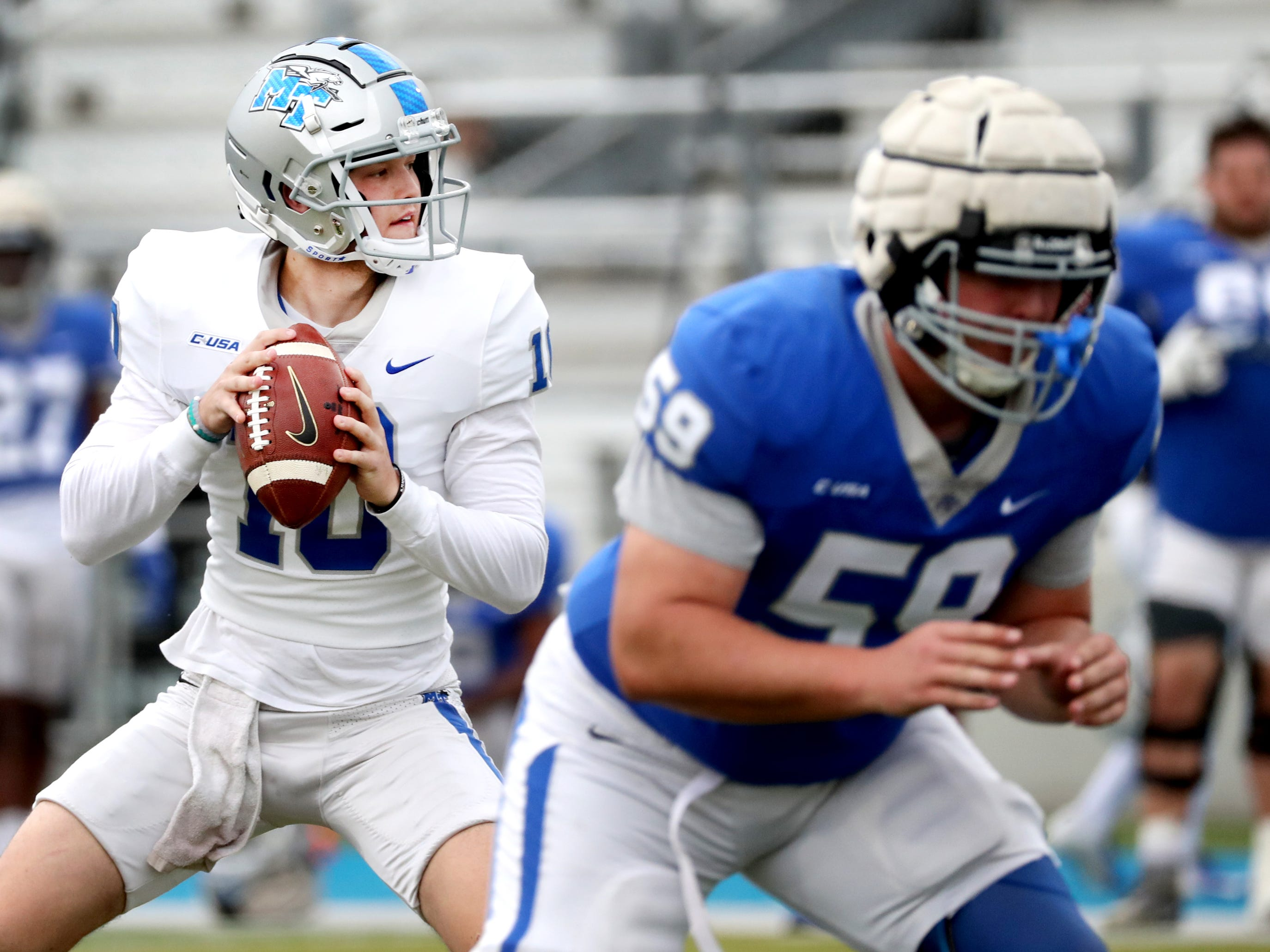 "MTSU's quarterback Asher O'Hara (10) loos for an open player to pass to during MTSU's Blue-White Spring Finale held on Saturday April 13, 2019, at MTSU's Johnny ""Red"" Floyd Stadium."